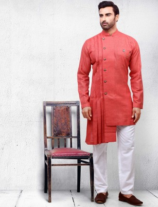 Orange hued cotton fabric kurta suit