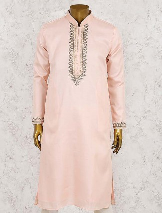 Party wear peach hued solid kurta suit
