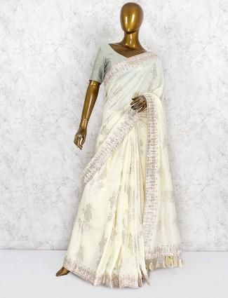 Party wear silk saree in cream color