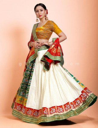 Patola silk green and white half n half semi stitched lehenga choli