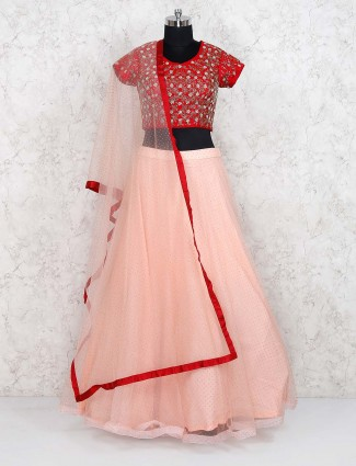 Peach and red net lehenga choli