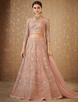 Peach color designer lehenga choli in net fabric