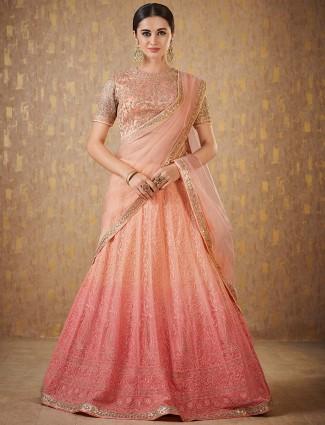 Peach color net wedding lehenga choli