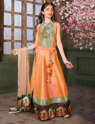 Peach colored party wear anarkali suit