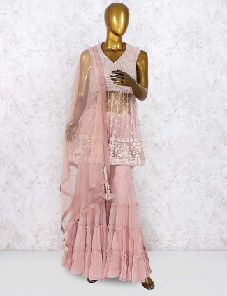 Peach hue amazing net fabric punjabi sharara suit