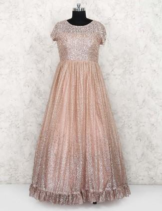 Peach hue net designer gown