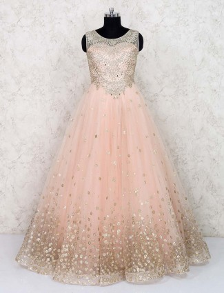 Peach hued bridal wear net fabric gown