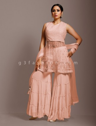 Peach net punjabi sharara suit in party