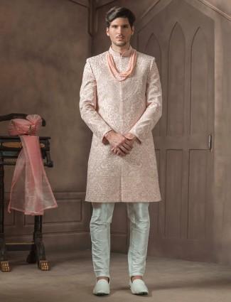 Peach raw silk groom sherwani with white bottom