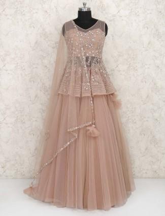 Peplum style peach colornet fabric party lehenga choli