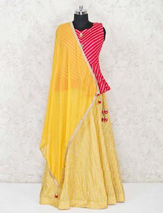 Pink and yellow leheriya concept lehenga with peplum top