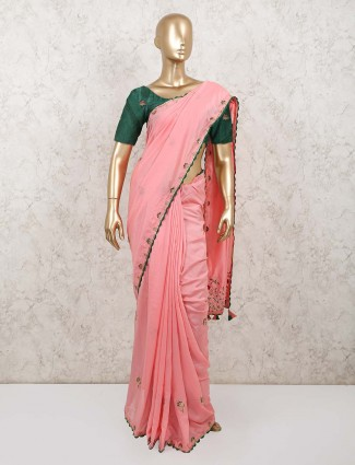 Pink georgette saree with contrast blouse for festive