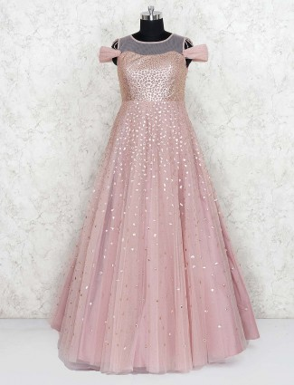 Pink hue net floor length gown for party wear