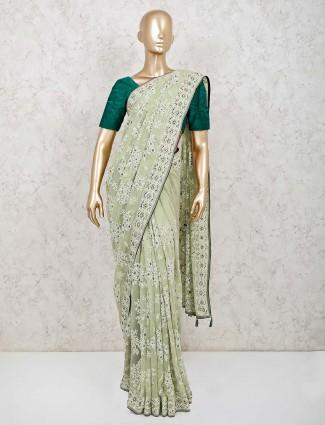 Pista green saree design in georgette