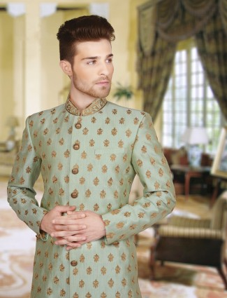 Pista green silk classic wedding wear sherwani