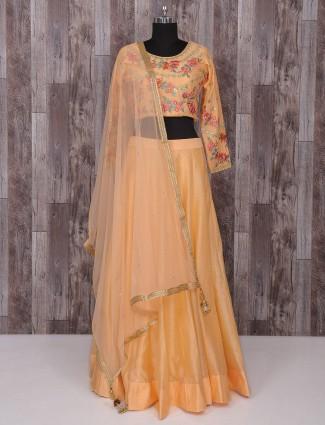 Plain peach hue silk party wear lehenga choli