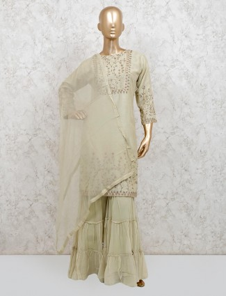 Punjabi sharara suit in pista green raw silk