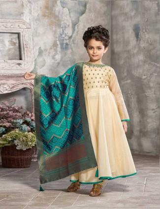 Rama green and cream anarkali suit