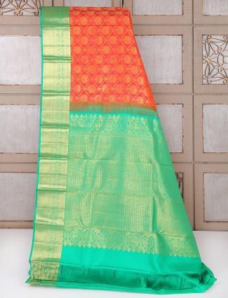 Red and green kanchipuram pattu wedding wear saree
