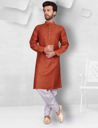 Rust orange color solid cotton kurta suit
