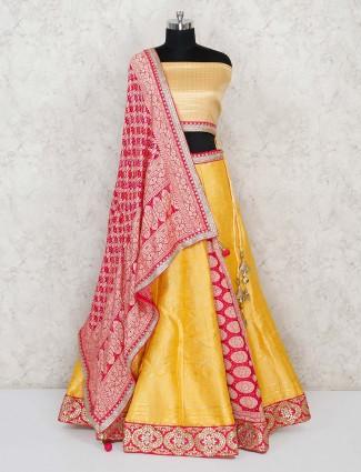 Semi stitcher yellow Banarasi lehenga choli in half and half pattern