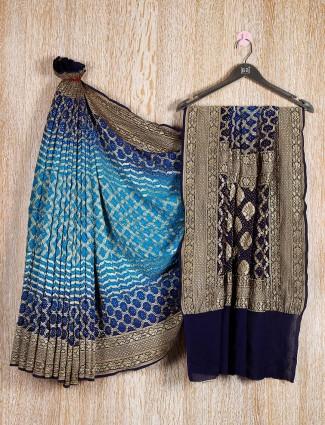 Sky blue, navy, and black colored bandhej saree