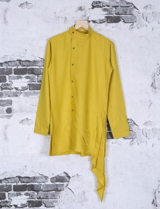 Solid festive wear kurta suit in yellow color
