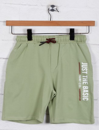 Solid green cotton shorts for boys
