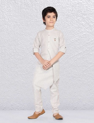 Solid party function beige kurta suit