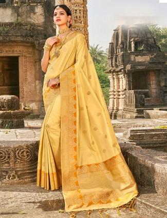 Spectacular cream banarasi silk saree for wedding occasion