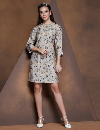 Stylish beige tunic in floral print