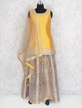 Taffeta silk gold hue lehenga cum punjabi suit