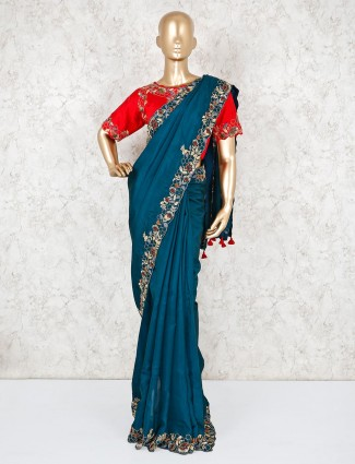 Teal green embroidered saree with readymade blouse