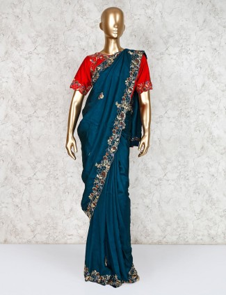 Teal green party wear saree in raw silk with ready made blouse