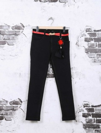 Tiny girl plain black denim jeans