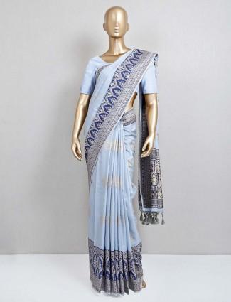Trendy semi silk blue festive wear saree