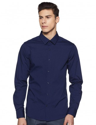 UCB solid navy hued cotton shirt