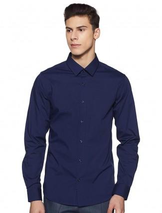 UCB solid navy hued cotton shirt