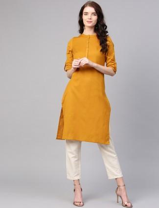 W mustard yellow solid cotton kurti
