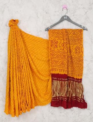 Wedding wear bandhej saree in yellow red combination