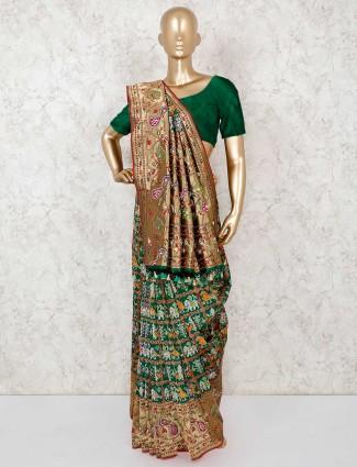 Wedding wear green patola silk saree