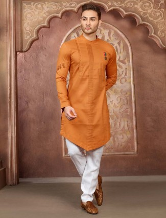 Wedding wear orange hue cotton silk kurta suit