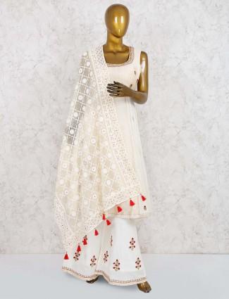 White color printed punjabi sharara suit