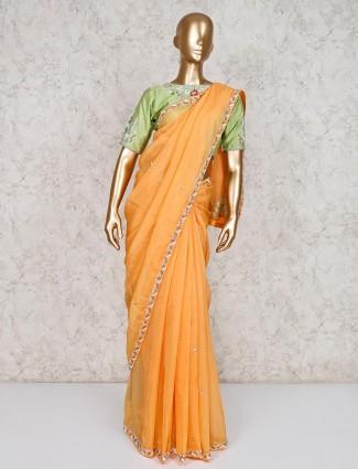 Wonderful orange satin saree with ready made blouse