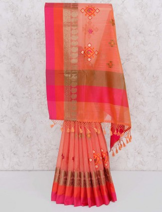 Wonderful peach color festive wear saree
