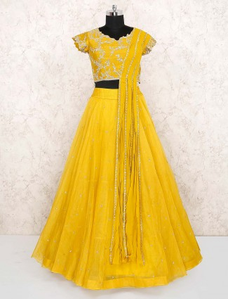 Yellow color lehenga choli in net