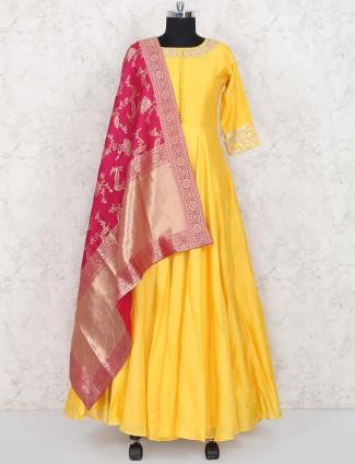 Yellow color raw silk floor length anarkali salwar suit