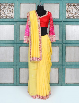 Yellow color wedding wear saree with ready made blouse