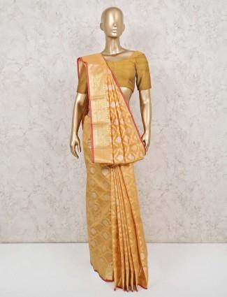 Yellow colored cotton banarasi silk saree