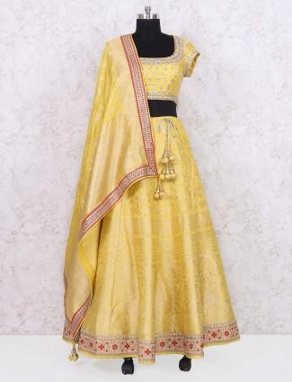Yellow hue banarasi party wear lehenga choli